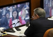 Cuba's President Raul Castro observes a monitor with he day's proceedings during the start of two-day session of the legislature, in Havana, Cuba, Wednesday, April 18, 2018. Cuba's legislature opened the two-day session that is to elect a successor to President Castro. (AP Photo/Ramon Espinosa)