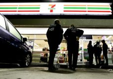 """FILE - In this Jan. 10, 2018, file photo U.S. Immigration and Customs Enforcement agents serve an employment audit notice at a 7-Eleven convenience store in Los Angeles. Immigration officials have sharply increased audits of companies to verify that their employees are authorized to work in the country, signaling the Trump administration's crackdown on illegal immigration is reaching deeper into the workplace to create a """"culture of compliance"""" among employers who rely on immigrant labor. (AP Photo/Chris Carlson, File)"""