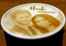 Capuccino coffees with the picture of Britain's Prince Harry and Meghan Markle on top are pictured at a coffee shop in Windsor, Tuesday, May 15, 2018. Preparations are being made in the town ahead of the wedding of Britain's Prince Harry and Meghan Markle that will take place in Windsor on Saturday May 19.(AP Photo/Frank Augstein)