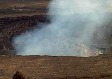 This Sunday, May 6, 2018, image from a research camera mounted in the observation tower at the Hawaiian Volcano Observatory and provided by the U.S. Geological Survey, shows the summit of the Kilauea volcano on the Big Island of Hawaii. The camera is looking south southeast towards the active vent in Halemaʻumaʻu, 1.9 km (1.2 miles) from the webcam. For scale, the crater wall of Halemaʻumaʻu behind the eruptive vent is about 85-meters (about 280-feet) high. Lava shooting out of openings in the ground have already destroyed nearly half a dozen homes while some 1,700 people who evacuated the area face the possibility of not being able to return for a long time. (U.S. Geological Survey via AP)