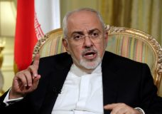 "FILE - In this April 24, 2018, file photo, Iran's Foreign Minister Mohammad Javad Zarif is interviewed by The Associated Press, in New York. Zarif has taken to YouTube on Thursday, May 3, to criticize President Donald Trump's threat to withdraw from the nuclear deal, saying Iran will not ""renegotiate or add onto"" the atomic accord. (AP Photo/Richard Drew, File)"