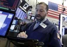 Trader Greg Mulligan works on the floor of the New York Stock Exchange, Wednesday, May 2, 2018. Stocks are opening moderately lower as Wall Street reacts to another big round of company earnings. (AP Photo/Richard Drew)