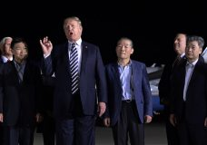 President Donald Trump speaks as he stands with Tony Kim, second left, Kim Dong Chul, center right, and Kim Hak Song, right, three Americans detained in North Korea for more than a year, after they arrived at Andrews Air Force Base in Md., Thursday, May 10, 2018. Vice President Mike Pence, left, and Secretary of State Mike Pompeo, second from right, listen. (AP Photo/Susan Walsh)