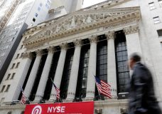 FILE- In this April 5, 2018, file photo, a pedestrian passes the New York Stock Exchange. The U.S. stock market opens at 9:30 a.m. EDT on Friday, June 29. (AP Photo/Richard Drew, File)