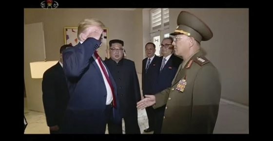 In this image made from June 12, 2018, video released by KRT, U.S. President Donald Trump salutes No Kwang Chol, minister of the People's Armed Forces of North Korea, as North Korean leader Kim Jong Un, center, introduces Trump to the general during the summit in Singapore. (KRT via AP Video)
