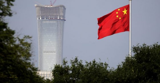 A Chinese national flag at Tiananmen Square flutters against the capital city tallest skyscraper China Zun Tower under construction at the Central Business District in Beijing Thursday, June 14, 2018. U.S. President Donald Trump approved a plan to impose punishing tariffs on tens of billions of dollars of Chinese goods as early as Friday, a move that could put his trade policies on a collision course with his push to rid the Korean Peninsula of nuclear weapons. (AP Photo/Andy Wong)