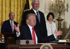 "President Donald Trump gestures as he signs a ""Space Policy Directive"" during a meeting of the National Space Council in the East Room of the White House, Monday, June 18, 2018, in Washington, as Vice President Mike Pence watches. AP Photo/Susan Walsh)"