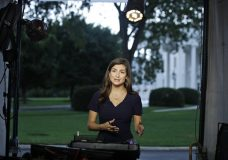 """CNN White House correspondent Kaitlan Collins talks during a live shot in front of the White House, Wednesday, July 25, 2018, in Washington. Collins says the White House denied her access to President Donald Trump's Rose Garden statement with the European Union Commission president because officials found her earlier questions """"inappropriate."""" (AP Photo/Alex Brandon)"""
