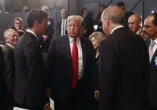 President Donald Trump, center, stops to talk with Spanish Prime Minister Pedro Sanchez, left, and Turkey's President Recep Tayyip Erdogan, right, as they attend a meeting of the North Atlantic Council during a summit of heads of state and government at NATO headquarters in Brussels on Wednesday, July 11, 2018. NATO leaders gather in Brussels for a two-day summit to discuss Russia, Iraq and their mission in Afghanistan.(AP Photo/Pablo Martinez Monsivais/pool)