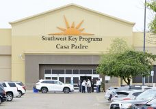 "FILE - In this June 18, 2018 file photo, dignitaries take a tour of Southwest Key Programs Casa Padre, a U.S. immigration facility in Brownsville, Texas, where children who have been separated from their families are detained. The American Civil Liberties Union says it appears the Trump administration will miss a Tuesday, July 10 deadline to reunite young children with their parents in more than half of the cases. The group said the administration provided it with a list of 102 children under 5 years old who must be reunited by Tuesday under an order by U.S. District Judge Dana Sabraw in San Diego. It said in a statement that it ""appears likely that less than half will be reunited"" by that deadline. (Miguel Roberts /The Brownsville Herald via AP, File)"