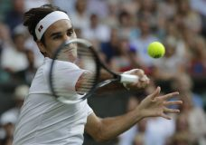 Switzerland's Roger Federer returns the ball to Germany's Jan-Lennard Struff during their men's singles match, on the fifth day of the Wimbledon Tennis Championships in London, Friday July 6, 2018. (AP Photo/Ben Curtis)