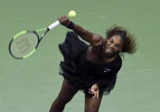 Serena Williams, of the United States, serves to Magda Linette, of Poland, during the first round of the U.S. Open tennis tournament, Monday, Aug. 27, 2018, in New York. (AP Photo/Jason DeCrow)