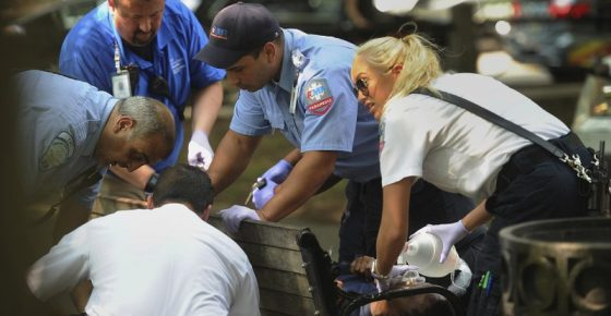 FILE - In this Thursday, Aug. 16, 2018 file photo, paramedics and EMT members respond to one of three simultaneous drug overdose victims on the New Haven Green, a city park in New Haven, Conn. Police swarmed a Connecticut park near Yale University and searched people's homes for drugs Thursday in an effort to prevent more overdoses from a batch of synthetic marijuana blamed for sending more than 70 people to the hospital. (Brian A. Pounds/Hearst Connecticut Media via AP)