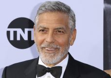 FILE - In this June 7, 2018, file photo, George Clooney arrives at the 46th AFI Life Achievement Award Honoring himself at the Dolby Theatre in Los Angeles. Clooney tops the 2018 Forbes' list of highest-paid actors with $239 million in pretax earnings. Forbes credits up to $1 billion that a British conglomerate said it would pay for Casamigos Tequila, which Clooney co-founded in 2013 with two entrepreneurs. (Photo by Willy Sanjuan/Invision/AP, File)