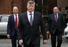 Members of the defense team for Paul Manafort, including Jay Nanavati, left, Kevin Downing, and Thomas Zehnle, walk to federal court for jury deliberations in the trial of the former Trump campaign chairman, in Alexandria, Va., Tuesday, Aug. 21, 2018. (AP Photo/Jacquelyn Martin)