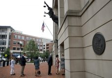 Members of the media wait in line to enter federal court as jury deliberations continue in the trial of former Donald Trump campaign chairman Paul Manafort, in Alexandria, Va., Tuesday, Aug. 21, 2018. (AP Photo/Jacquelyn Martin)