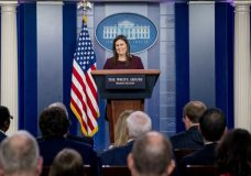White House press secretary Sarah Huckabee Sanders smiles as she speaks to the media during the daily press briefing at the White House, Tuesday, Aug. 14, 2018, in Washington. Sanders took questions about former White House staffer Omarosa Manigault and other topics. (AP Photo/Andrew Harnik)