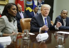 """FILE - In this Feb. 1, 2017, file photo, President Donald Trump, center, is flanked by White House staffer Omarosa Manigault Newman, left, and then-Housing and Urban Development Secretary-designate Ben Carson as he speaks during a meeting on African American History Month in the Roosevelt Room of the White House in Washington. Manigault Newman, who was fired in December, released a new book """"Unhinged,"""" about her time in the White House. (AP Photo/Evan Vucci, File)"""