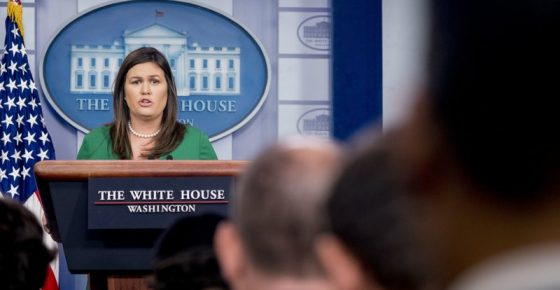 White House press secretary Sarah Huckabee Sanders reads a statement from President Donald Trump announcing that he will remove the security clearance from former CIA Director John Brennan during the daily press briefing at the White House, Wednesday, Aug. 15, 2018, in Washington. Sanders said the president will be reviewing the security clearances for a number of other former officials. (AP Photo/Andrew Harnik)