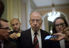Sen. Chuck Grassley, R-Iowa, walks past members of the media as he heads to the Senate Chamber floor on Capitol Hill in Washington, Tuesday, Sept. 18, 2018. (AP Photo/Pablo Martinez Monsivais)