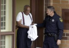Bill Cosby is escorted out of the Montgomery County Correctional Facility Tuesday Sept. 25, 2018 in Eagleville, Pa., following his sentencing to three-to-10-year prison sentence for sexual assault. (AP Photo/Jacqueline Larma)