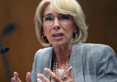 "FILE - In this June 5, 2018, file photo, Education Secretary Betsy DeVos testifies during hearing on the FY19 budget on Capitol Hill in Washington. A federal court has ruled that a decision by DeVos to delay an Obama-era rule meant to protect students swindled by for-profit colleges was ""arbitrary and capricious,"" dealing a significant blow to the Trump administration's attempt to ease regulations for the industry. (AP Photo/Carolyn Kaster, File)"
