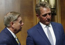 Sen. Jeff Flake, R- Ariz., right, walks out at the end of the Senate Judiciary Committee meeting with Sen. Lindsey Graham, R-S.C., Friday, Aug. 28, 2018 on Capitol Hill in Washington. (AP Photo/Pablo Martinez Monsivais)