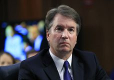 FILE - In this Sept. 4, 2018 photo, Supreme Court nominee Brett Kavanaugh, listens to Sen. Cory Booker, D-N.J. speak during a Senate Judiciary Committee nominations hearing on Capitol Hill in Washington. FBI agents interviewed one of the three women who have accused Kavanaugh of sexual misconduct as Republicans and Democrats quarreled over whether the bureau would have enough time and freedom to conduct a thorough investigation before a high-stakes vote on his nomination to the nation's highest court. (AP Photo/Manuel Balce Ceneta, File)