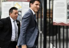 Canadian Prime Minister Justin Trudeau arrives on Parliament Hill in Ottawa, Ontario on Monday, Oct. 1, 2018. The U.S. and Canada reached the basis of a free trade deal Sunday night, a senior Canadian government official said. (Justin Tang/The Canadian Press via AP)