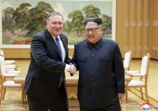 """FILE - In this May 9, 2018, file photo provided by the North Korean government, U.S. Secretary of State Mike Pompeo, left, shakes hands with North Korean leader Kim Jong Un during a meeting at Workers' Party of Korea headquarters in Pyongyang, North Korea. North Korea warned Washington through its state media Tuesday, Oct. 2, that a declaration ending the Korean War shouldn't be seen as a bargaining chip in denuclearization talks — but suggested lifting sanctions might be. Independent journalists were not given access to cover the event depicted in this image distributed by the North Korean government. The content of this image is as provided and cannot be independently verified. Korean language watermark on image as provided by source reads: """"KCNA"""" which is the abbreviation for Korean Central News Agency. (Korean Central News Agency/Korea News Service via AP, File)"""