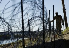 Members of the U.S. military install concertina wire along the banks of the Rio Grande near the Juarez-Lincoln Bridge at the U.S.-Mexico border. (AP Photo/Eric Gay)