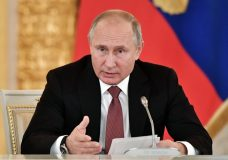 """Russian President Vladimir Putin speaks during a meeting in Moscow's Kremlin, Russia, Tuesday, Nov. 27, 2018. Putin and German Chancellor Angela Merkel spoke on the phone in the early hours on Tuesday, and the Russian president expressed a """"serious concern"""" about what the martial law in Ukraine might entail. The Kremlin warned Tuesday that Ukraine's declaration of martial law over Russia's seizure of three Ukrainian ships might trigger a flare-up in hostilities in eastern Ukraine, while Kiev blamed Russia for parading captured Ukrainian seamen on television. (Alexei Nikolsky, Sputnik, Kremlin Pool Photo via AP)"""