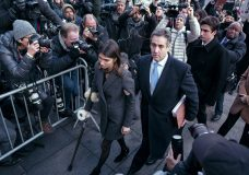 ADDS NAME OF FAMILY MEMBERS - Michael Cohen, center, President Donald Trump's former lawyer, accompanied by his children Samantha, left, and Jake, right, arrives at federal court for his sentencing, Wednesday, Dec. 12, 2018, in New York, for dodging taxes, lying to Congress and violating campaign finance laws. (AP Photo/Craig Ruttle)