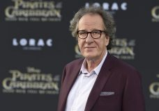"""FILE - In this May 18, 2017, file photo, Geoffrey Rush arrives at the Los Angeles premiere of """"Pirates of the Caribbean: Dead Men Tell No Tales"""" at the Dolby Theatre. """"Orange Is the New Black"""" actress Yael Stone alleges actor Geoffrey Rush engaged in sexually inappropriate behavior when they starred in """"The Diary of a Madman"""" in 2010. (Photo by Jordan Strauss/Invision/AP, File)"""