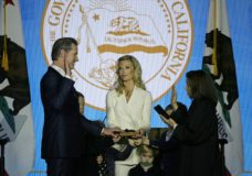 California Governor Gavin Newsom takes the oath of office from state Supreme Court Chief Justice Tani Gorre Cantil-Sakauye as his wife Jennifer Siebel Newsom looks on during his inauguration Monday, Jan. 7, 2019, in Sacramento, Calif. (AP Photo/Eric Risberg)