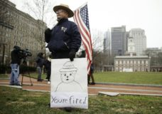 David Fitzpatrick an employee of the the National Park Service demonstrated against the partial government shutdown in view of Independence Hall in Philadelphia, Tuesday, Jan. 8, 2019. (AP Photo/Matt Rourke)