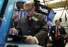 Trader Andrew Silverman, center, works on the floor of the New York Stock Exchange, Tuesday, Jan. 8, 2019. Stocks are opening broadly higher on Wall Street, building on two days of solid gains. (AP Photo/Richard Drew)