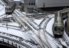 """Chicago's El trains move along snow-covered tracks Monday, Jan. 28, 2019, in Chicago. The plunging temperatures expected later this week that have forecasters especially concerned. Wind chills could dip to negative 55 degrees in northern Illinois, which the National Weather Service calls """"possibly life threatening."""" (AP Photo/Kiichiro Sato)"""