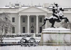 Snow blankets a statue of Andrew Jackson in Lafayette Square with the White House behind, as a winter storm arrives in the region, Sunday, Jan. 13, 2019, in Washington. (AP Photo/Alex Brandon)