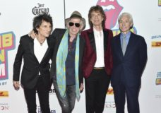 "FILE - In this Nov. 15, 2016 file photo, The Rolling Stones, from left, Ronnie Wood, Keith Richards, Mick Jagger and Charlie Watts attend the opening night party for ""Exhibitionism"" at Industria in New York. The New Orleans Jazz and Heritage Festival has got satisfaction: The Rolling Stones are among headliners for the 50th anniversary festival. Organizers Tuesday, Jan. 15, 2019, confirmed reports that Mick Jagger and his band will play. (Photo by Evan Agostini/Invision/AP, File)"