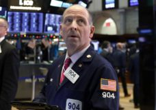 FILE- In this Dec. 27, 2018, file photo trader Michael Urkonis works on the floor of the New York Stock Exchange. The U.S. stock market opens at 9:30 a.m. EST on Thursday, Jan. 31. (AP Photo/Richard Drew, File)
