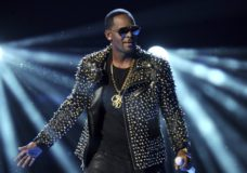"FILE - In this June 30, 2013 file photo, R. Kelly performs at the BET Awards in Los Angeles. A Georgia man involved with a recent documentary detailing abuse allegations against R. Kelly told police the singer's manager threatened him. A Stockbridge police report says Timothy Savage told an officer on Jan. 3 that Don Russell had texted him saying it would be best for him and his family if the documentary didn't air. Savage said he and his wife were involved with Lifetime's ""Surviving R. Kelly"" series. (Photo by Frank Micelotta/Invision/AP, File)"