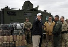 President Donald Trump tours the U.S. border with Mexico at the Rio Grande on the southern border, Thursday, Jan. 10, 2019, in McAllen, Texas. (AP Photo/ Evan Vucci)