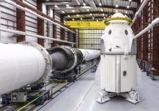 In this Dec. 18, 2018 photo provided by SpaceX, SpaceX's Crew Dragon spacecraft and Falcon 9 rocket are positioned inside the company's hangar at Launch Complex 39A at NASA's Kennedy Space Center in Florida, ahead of the Demo-1 unmanned flight test. SpaceX rockets closer to human spaceflight with this weekend's debut of a new capsule designed for astronauts. The six-day test flight will be real in every regard, beginning with a Florida liftoff Saturday, March 2, 2019, and a docking the next day with the International Space Station. But the Dragon capsule won't carry humans, rather a test dummy in the same white SpaceX spacesuit that astronauts will wear. (Space X via AP)