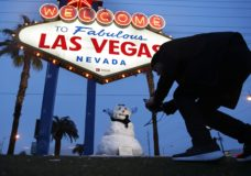 """A man, who declined to give his name, takes a picture of a small snowman at the """"Welcome to Fabulous Las Vegas"""" sign along the Las Vegas Strip, Thursday, Feb. 21, 2019, in Las Vegas. Las Vegas is getting a rare taste of real winter weather, with significant snowfall across the metro area in the first event of its kind since record keeping started back in 1937. (AP Photo/John Locher)"""