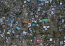 een from a drone Praia Nova Village, one of the most affected neighbourhoods in Beira, razed by the passing cyclone, in the coastal city of Beira, Mozambique, Sunday March 17, 2019. Families are returning to the vulnerable shanty town following cyclone high winds and rain. More than 1,000 people are feared dead in Mozambique four days after a cyclone slammed into the southern African country. (Josh Estey/CARE via AP)