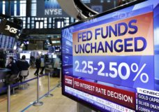 "A screen on the floor of the New York Stock Exchange shows the rate decision of the Federal Reserve, Wednesday, March 20, 2019. The Federal Reserve is leaving its key interest rate unchanged and projecting no rate hikes in 2019, dramatically underscoring its plan to be ""patient"" about any further increases. (AP Photo/Richard Drew)"