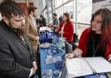 In this Thursday, March 7, 2019, photo visitors to the Pittsburgh veterans job fair meet with recruiters at Heinz Field in Pittsburgh. On Friday, March 8, the U.S. government issues the February jobs report, which will reveal the latest unemployment rate and number of jobs U.S. employers added. (AP Photo/Keith Srakocic)