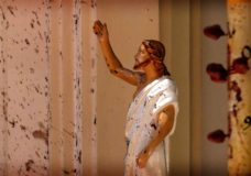 Blood stains are seen on the wall and on a Jesus Christ statue at the St. Sebastian's Church after blast in Negombo, north of Colombo, Sri Lanka, Sunday, April 21, 2019. More than two hundred people were killed and hundreds more injured in eight blasts that rocked churches and hotels in and just outside Sri Lanka's capital on Easter Sunday. (AP Photo)