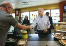Democratic presidential candidate and former Vice President Joe Biden greets people at Gianni's Pizza, in Wilmington Del., Thursday, April 25, 2019. Jessica Griffin/The Philadelphia Inquirer via AP)